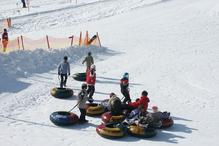 SnowTubing (c) Tourist Office Piesendorf Niedernsill, Photo Harry Liebmann
